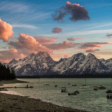 A Tetons Mountains sunset on a lake in Teton National Park.
