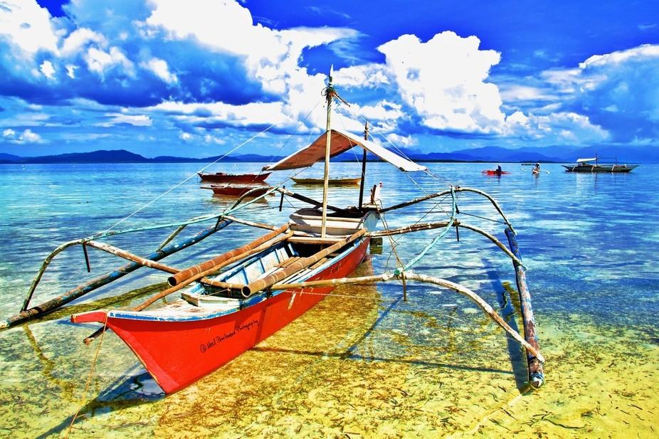 Katig or outrigger, summer in Honda Bay, Palawan.