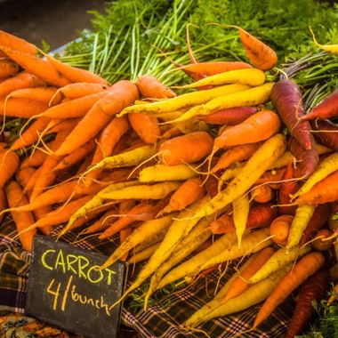 Multicolored carrots for sale at the farmer's market in Kaunakakai, on the island of Mololkai, Hawaii