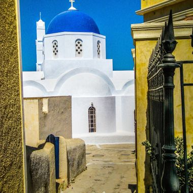 Alley leading to a small Greek Orthodox church in the city of Thera on the island of Santorini