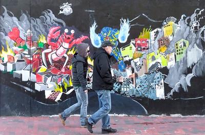 Walking Past Mural