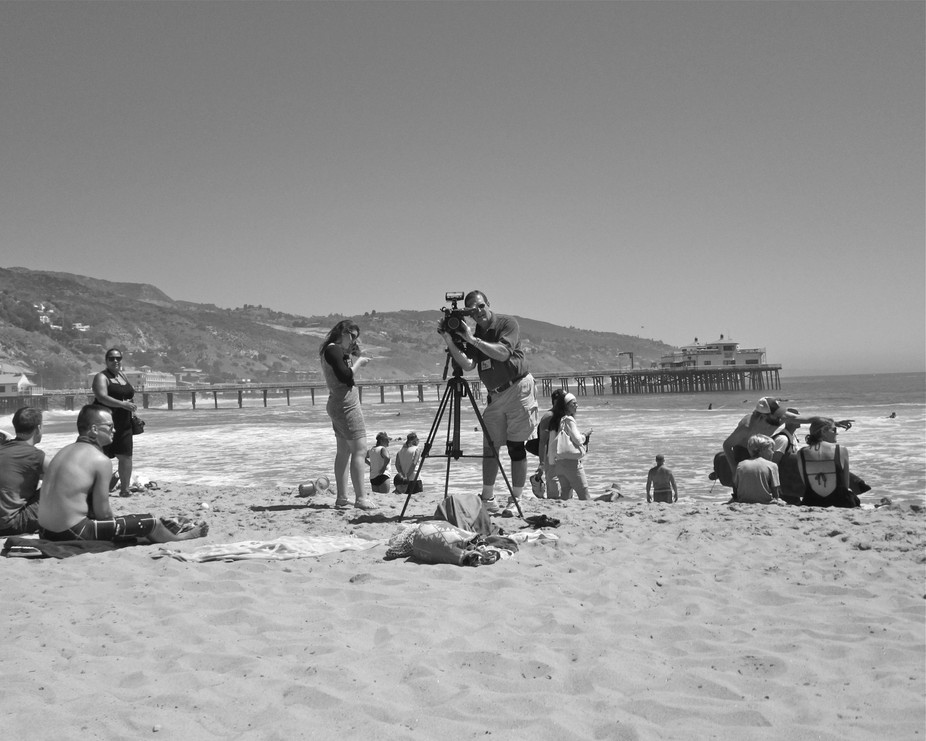 Malibu Beach, August 2014, the last day of a storm surge. Everyone\'s out to get a great picture.