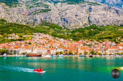 Red tourist submarine is sailing from the bay of Makarska