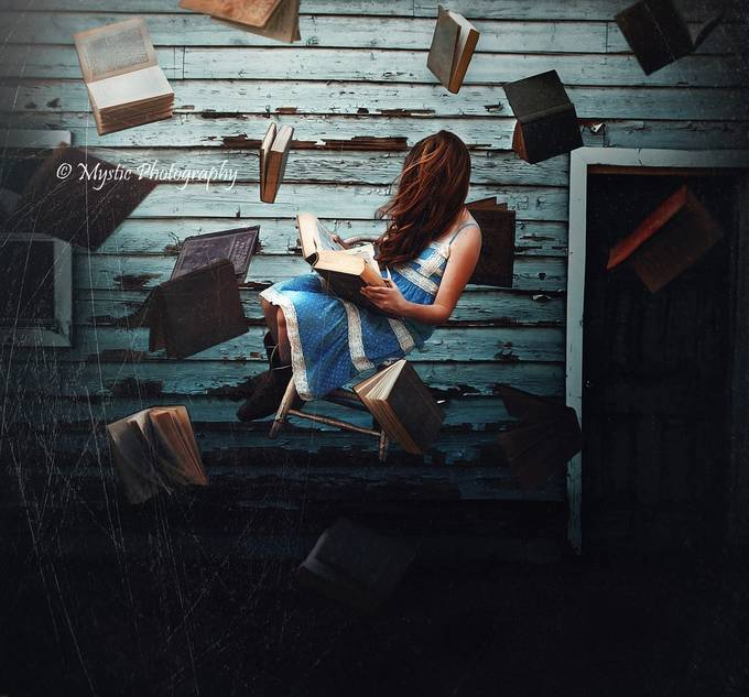 Bookworm by tylerrobertoxley - The Art Of Levitation Photo Contest