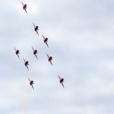 The Royal Air Force Red Arrows in their Arrow Formation head on. Pictured at Llandudno Air Show in May 2015.