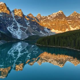 Lake Moraine Sunrise... however, if you look at the photo closely, there is a skull visible in the reflection! See if you can find it... it took ...