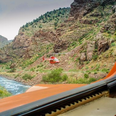 Seen from the cab of a diesel locomotive, old and new transportation passing on the Arkansas River in the Royal Gorge of Colorado.