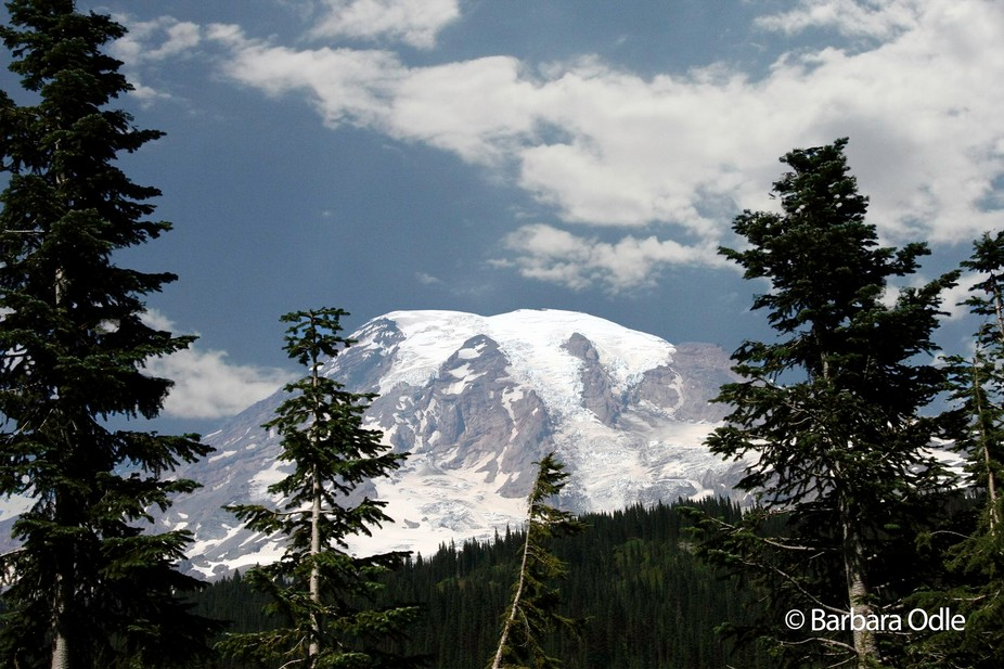 Mt Rainier in Washington State, USA is one of several peaks in the Cascade range and is really a ...