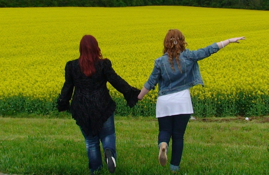 sisters having fun in the fields of flowers inTennessee