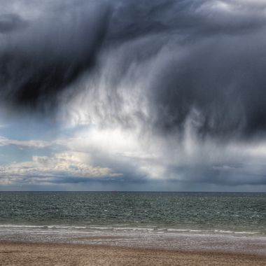 Storm approaching in Whitby. The clouds put the size of the people into perspective.