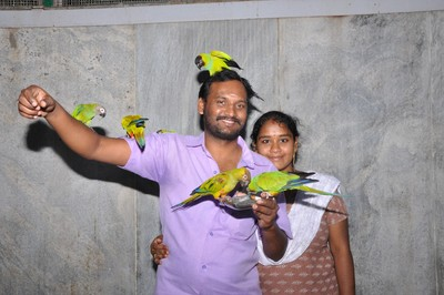 Me with my wife & Parrots