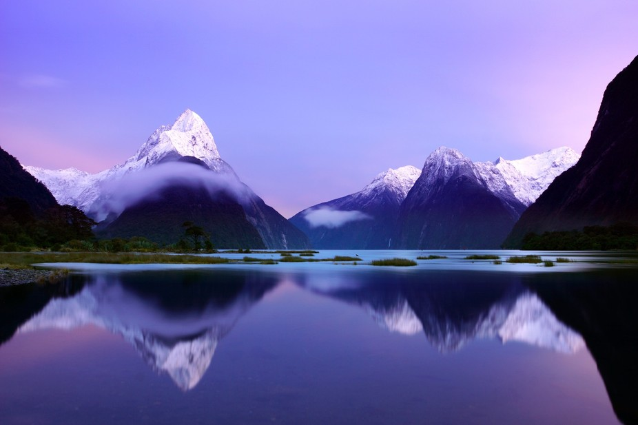 Sunrise captured of Milford Sound in New Zealand. It is Maori legend that this land is where the ...