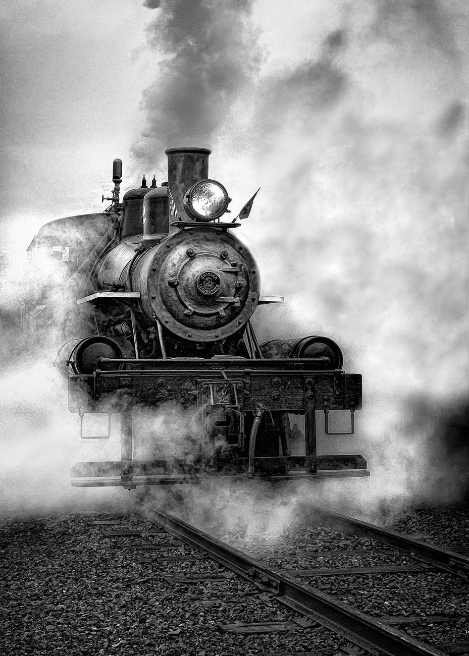 This photograph of a vintage train in Garibaldi, Oregon was captured on a rainy, foggy morning on the Oregon Coast. I timed the shot to capture the steam as it was released when the train was coming to a stop. The black and white conversion was accomplished using NIK Silver Efex Pro 2 using Afga 100 simulation and the underexposure preset. A custom preset was developed to enhance the highlights and shadows.