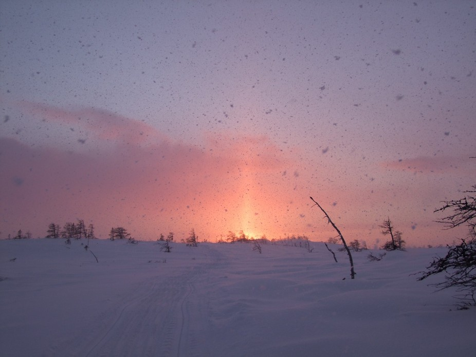 ride on ski doo and a sunset and then it started to snow ! Big snowflakes