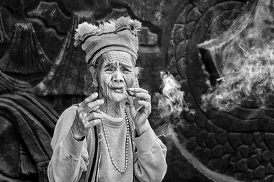 Old Asian Smoking Woman