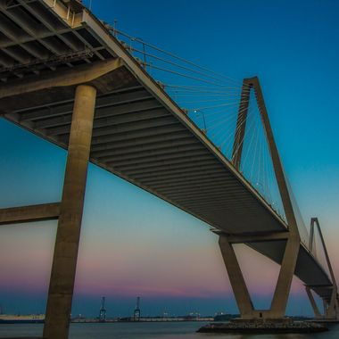 The Ravenel Bridge spans the Cooper River as it empties into Charleston Harbor on the coast of South Carolina.