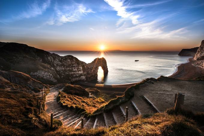 Durdle Door Starburst  by ollietaylorphotography - Around the World Photo Contest By Discovery