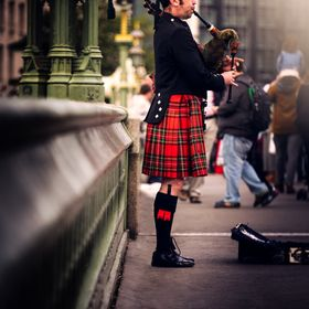 A Scottish Bagpiper in London