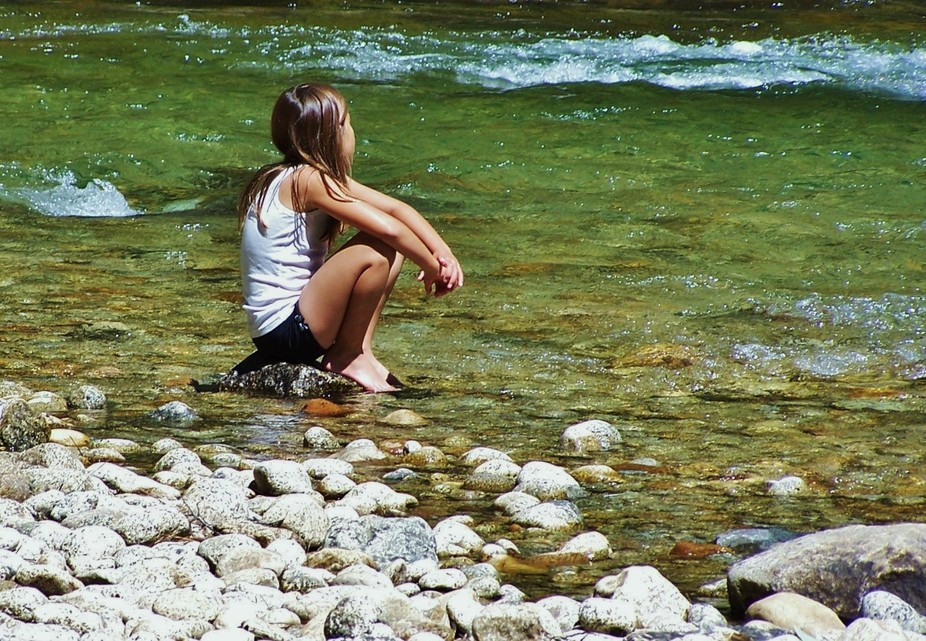 I caught my granddaughter in a moment of contemplation on the Kings River, Kings Canyon National ...