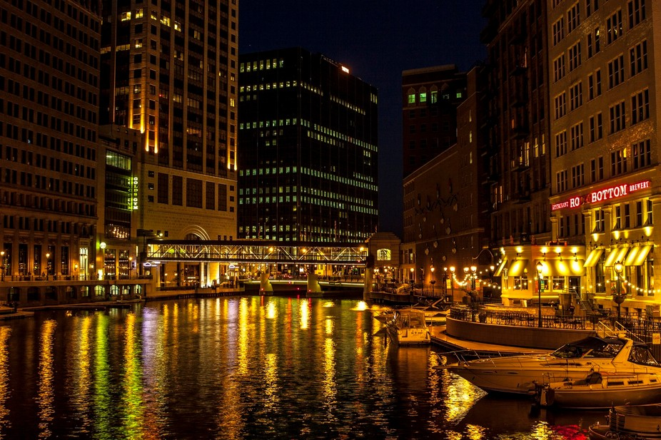 Downtown Milwaukee, WI, at night along the river walk,