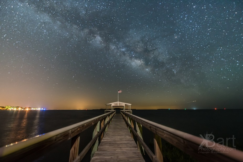 Milkyway over CedarKey with nice leading lines from the dock. The American flag waves in the bree...