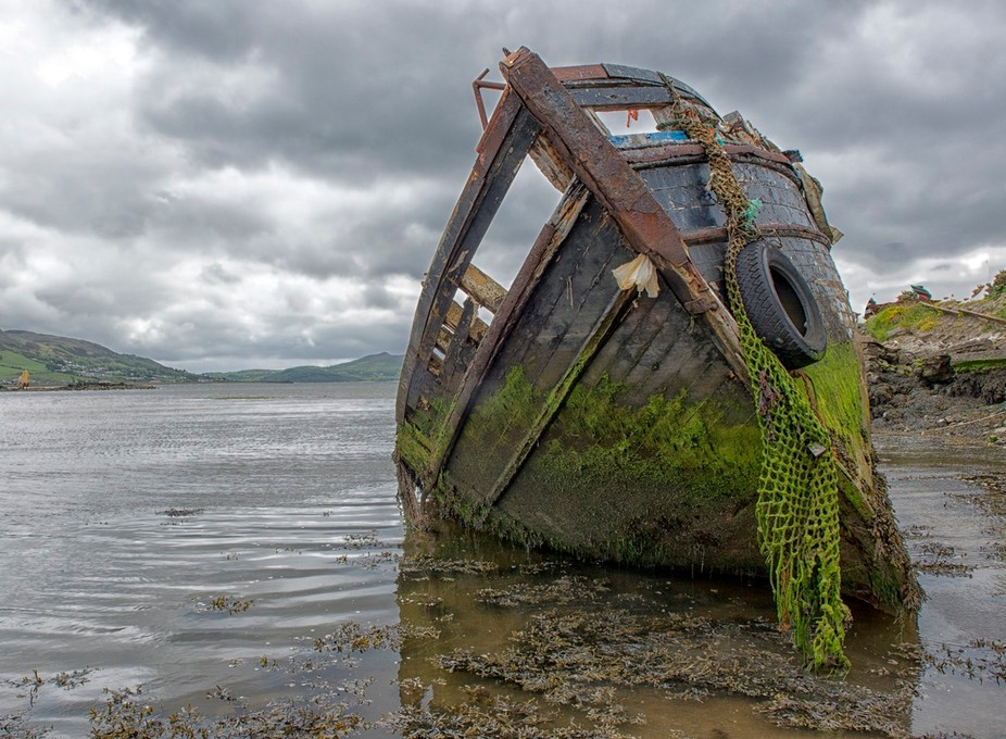 Abandoned boat in a jetty in a small town in Ireland