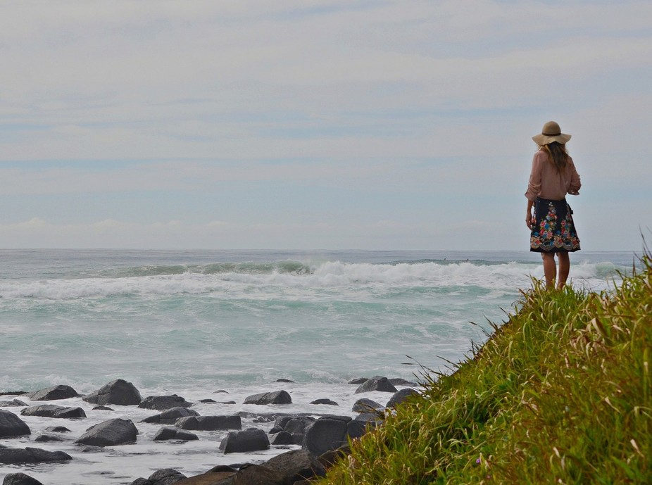 She was watching some surfers hidden around the headland.