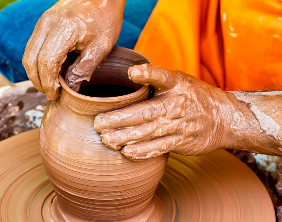 Pottery artist making a pot