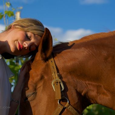 A new winery with spectacular views and unique wines in the Texas Hill Country, Hawk's Shadow is also a working ranch.  The owners were approached to host weddings from time to time, so we photographed a bride with one of the retired quarter horses in the vineyard.  They put each other at ease, and at one point became quite calm and close.  This image captured the serenity of that amazing experience.
