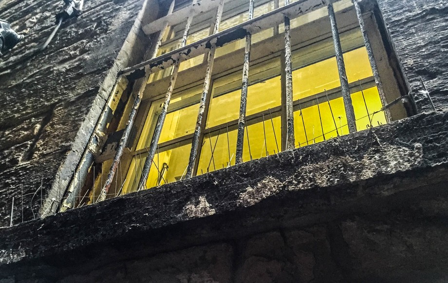 Found in a New Castle alleyway- the nails on the window are to prevent pigeons from nesting.