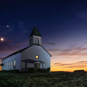 Jupiter, Venus and the moon set on the St. Boniface Catholic church, on Highway 80, about six miles west of Palo Pinto, Texas. Also called Dodson...