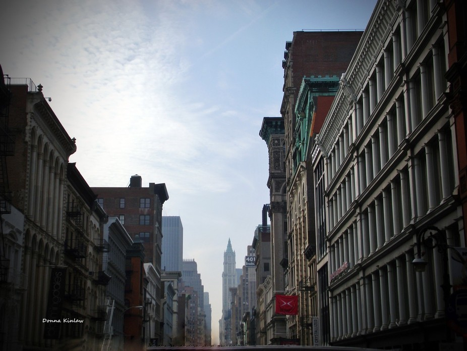 This is a picture of New York City with it\'s straight city streets.  I loved the lighting and col...