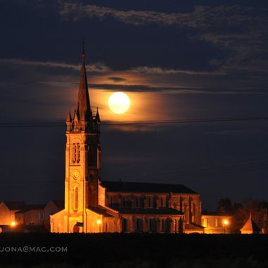 The harvest moon rises over L'Eglise de St Jean Baptiste in Pomerol, the tiny Bordeaux Right Bank Commune where legendary wines are created.   I was driving a tiny, beat-up Renault through Pomerol to a small winery for dinner, and when I turned on a small road through vineyards, this sight revealed itself.  I literally slammed on the brakes, braced the Nikon and monopod as best I could through the opening of the sunroof, leveled it off with a cork and a soft lens pouch, and fired away.  This picture, in October 2009, was a portent of the quality of that particular vintage, which is now widely acclaimed to be one of the greatest ever.
