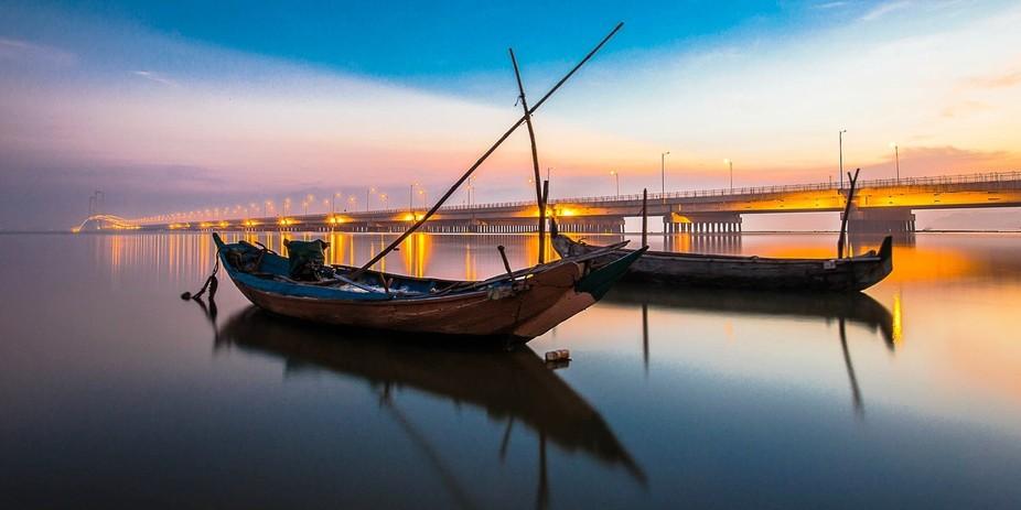 two boats leaning on the edge of Suramadu bridge