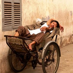 I spotted the resting driver down a side alley in Saigon, and having been a passenger many times I knew how exhausting it is to drive people around.