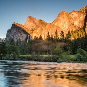 Yosemite gives and gives visually, of course, but then sometimes a golden sunset is added! Taken from the far bank when the insects started to bi...