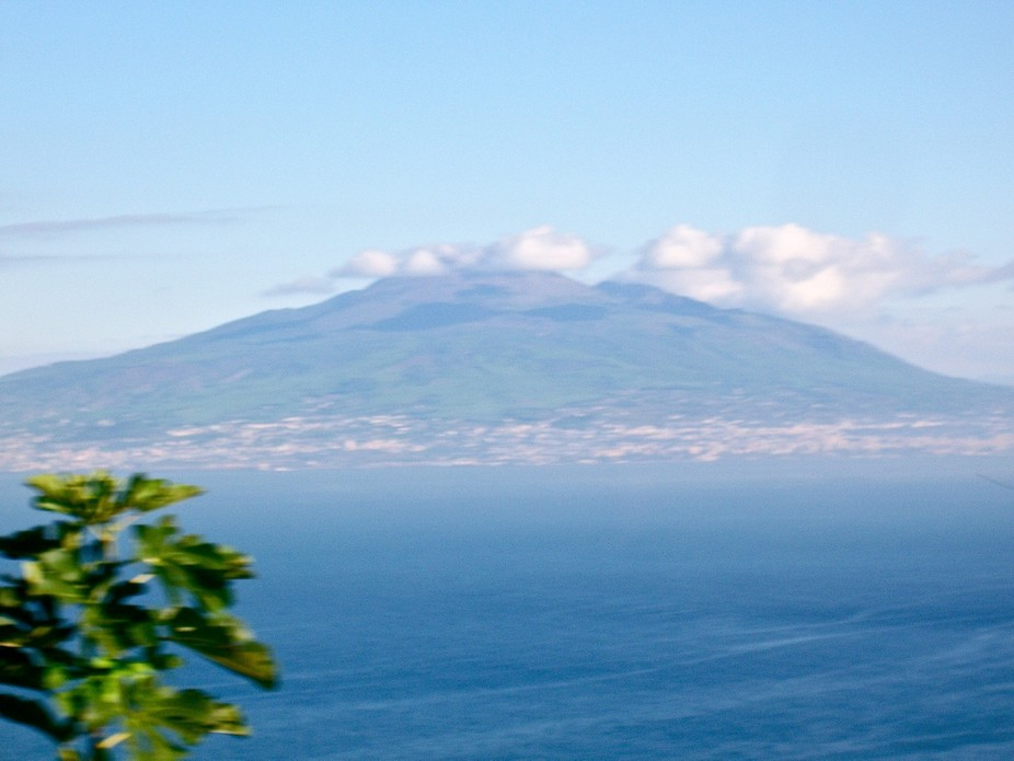 From across the bay, Vesuvius looks at peace, especially with the softly blurred clouds gracing i...