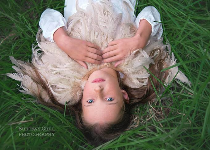 Girl in the Grass by BrionyWilliams - Subjects On The Ground Photo Contest
