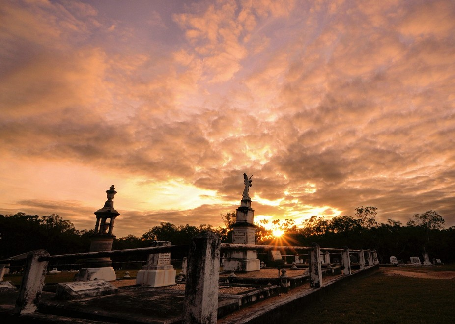 Some beautiful architectural elements in a small country cemetery with beautiful sunset lighting