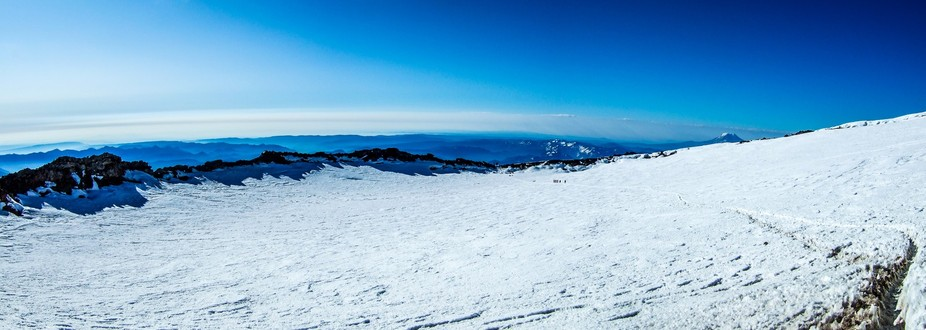 Those specks in the middle right are people. This is from just above the crater on Mt. Rainier in...