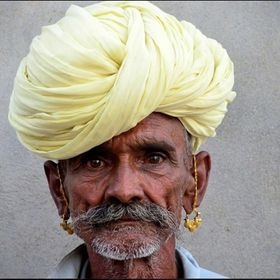 Rahjastani man taking part at a opium ceremony in Northern India.