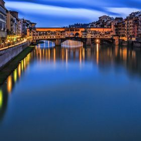 Very long exposure (~3 minutes) of the Ponte Vecchio bridge and Arno River in Florence, taken on a rainy evening.