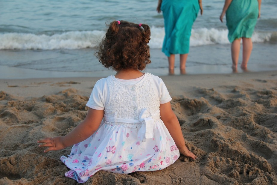 child by the beach