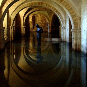 In the cold light of the basement of Winchester Cathedral, flooded from recent rains, the sculpture of Antony Gormly stands mute, appropriately g...