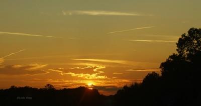 Sundown and Contrails