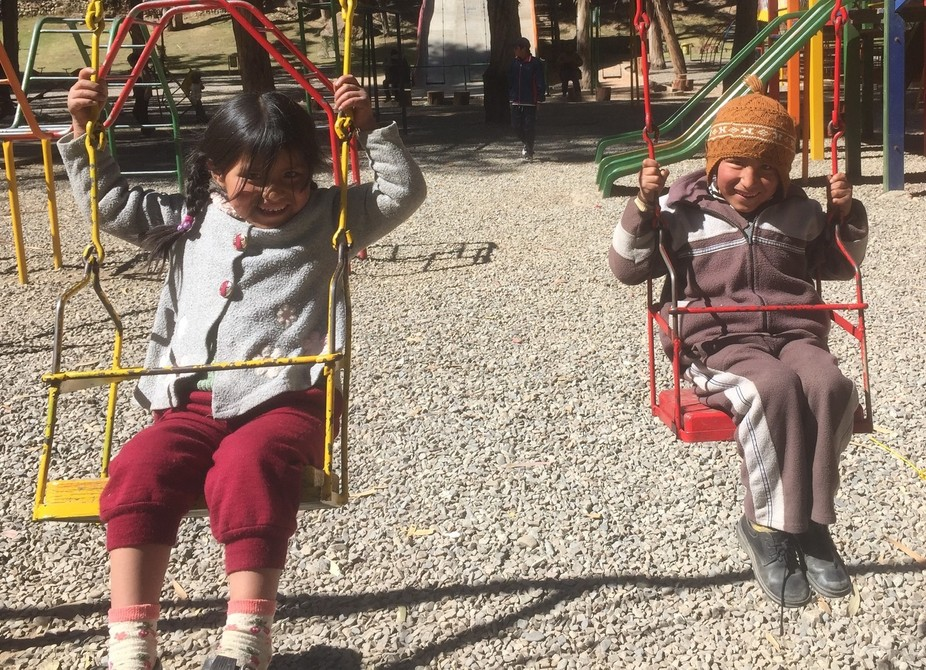 """An outing to a park in La Paz, Bolivia. These kids loved being pushed on the swings. """"Higher..."""