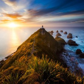 Perched high above the crashing ocean huge cliffs drop off to either side , balanced on a knife edge , tripod locked only marginally in place I w...