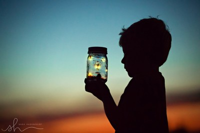 catching fireflies at sunset