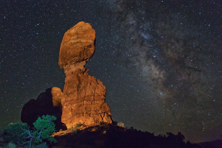 Balanced Rock in Arches National Park was illuminated by a passing car while I was making this ex...