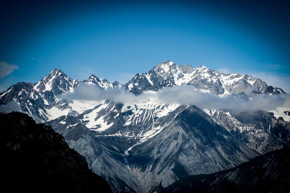 A scenic capture of a mountain range in Glacier National Park, Alaska